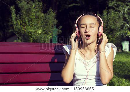 Girl listening to music on headphones sound