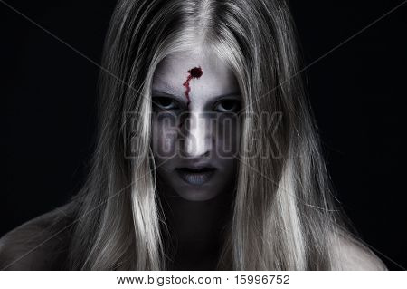 portrait of zombie with wound on forehead. halloween theme