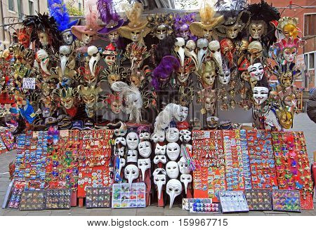 Venice Italy - November 23 2015: souvenirs and carnival masks outdoor in Venice Italy