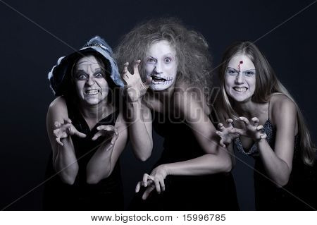 portrait of three anger halloween personages over dark background