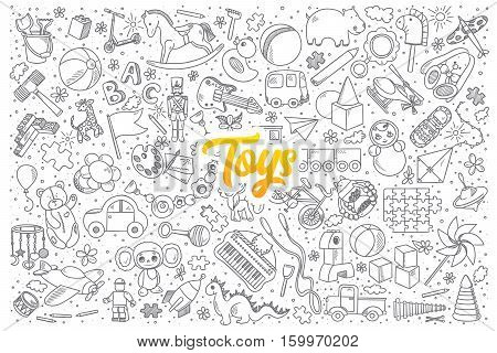 Hand drawn set of toys doodles with yellow lettering in vector