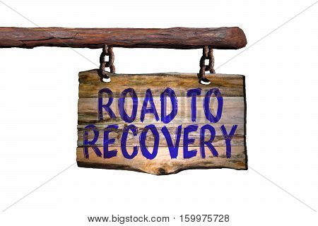 Road to recovery motivational phrase sign on old wood with blurred background