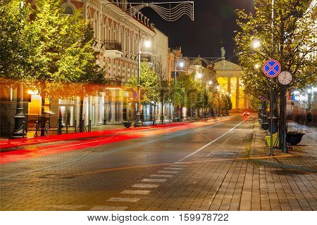 Gediminas prospect and Cathedral and luminous track from the car at night in Vilnius, Lithuania, Baltic states.