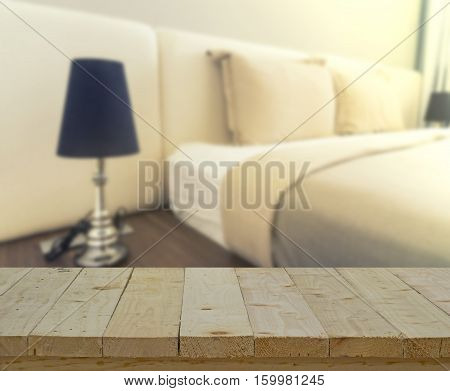 abstract wood table top on blur of bedroom with vintage filter - can use to display or montage on product