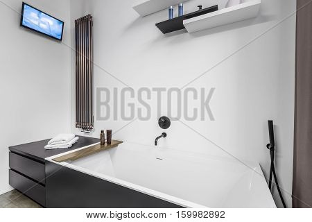 Bathroom With Tv And Bathtub