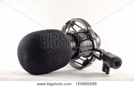 Microphone in front of a white backgound