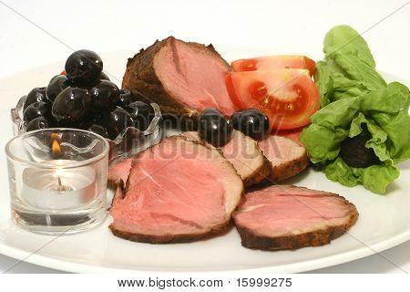 roast meat on dishware