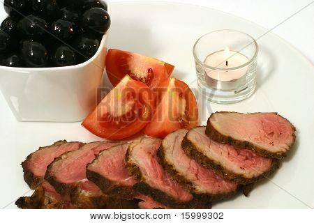 roast meat and tomatoes