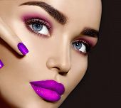 Beauty Brunette Woman with Perfect Makeup. Beautiful Professional Make-up. Red Lips and Nails, perfe poster
