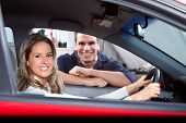 stock photo of car repair shop  - Handsome mechanic and woman in auto repair shop - JPG