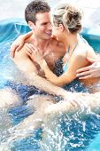 picture of hot-tub  - Young loving couple relaxing in a comfortable  jacuzzi - JPG