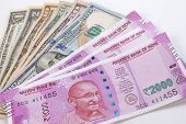 Постер, плакат: 2000 Rupee Banknote Over Us Dollar Banknote 2000 Rupee Publish On 9 November 2016 Indian And Usa E