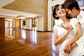 stock photo of woman couple  - Young happy couple at their new house - JPG