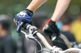 stock photo of extreme close-up  - Close up of a competitor on a mountain bike - JPG