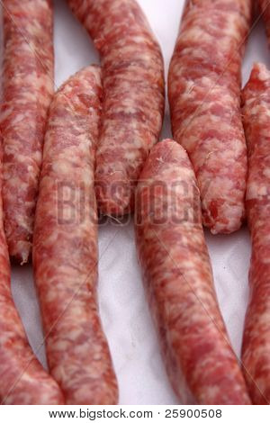 raw sausage links lined up for cooking
