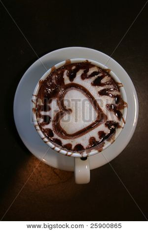 coffee with a heart in chocolate sauce for Valentines Day