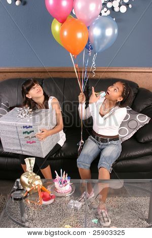 two young girls enjoy a birthday party