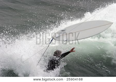 a surfer Wipes Out in Huntington Beach California aka Surf City