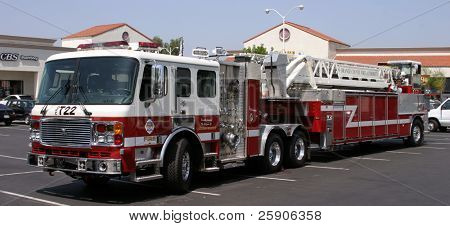 a fire truck in a parking lot cropped