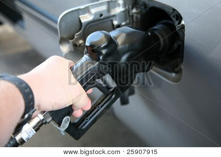pumping gas into a car