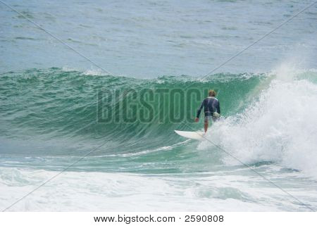 Surfer Surfing On Big Wave