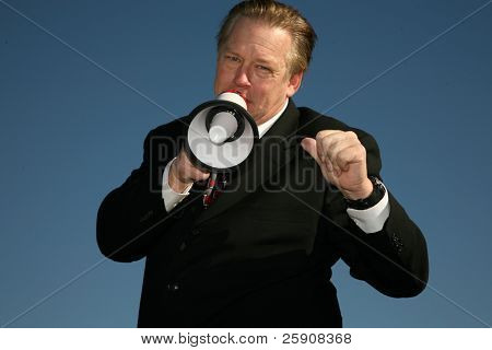 A handsome and friendly Business man speaks through a Megaphone to Get Your Message accross to the masses