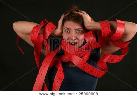 "a girl expresses frustration with the concept of being ""Caught up in Red Tape"""