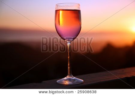 a glass of wine at sunset