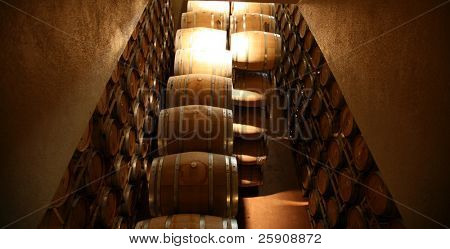 Oak Wine Barrels in a Winery in Napa California, fermenting wine for future drinking pleasure around the world