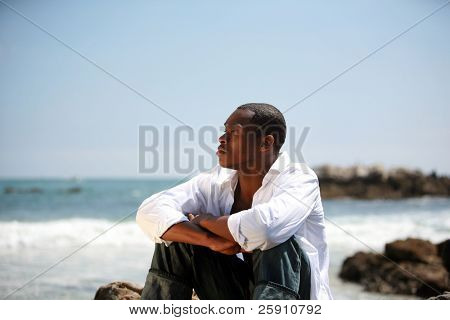a handsome male model enjoys a summer day at the beach