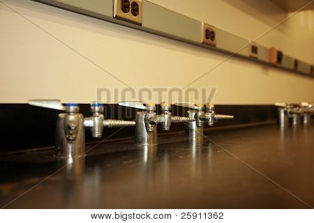 gas spigots on a work bench in a science lab