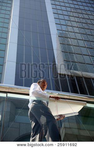 a contractor surveys his latest building