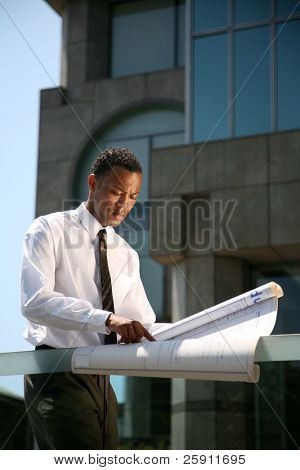 a contractor reviews his latest buildings blue prints