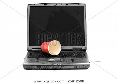 a laptop computer with spilled liquid on the keyboard in black and white and colorized isolated on white