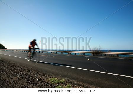 "bikers ride accross the ""Honoapi'ilani Highway"" on maui hawaii"