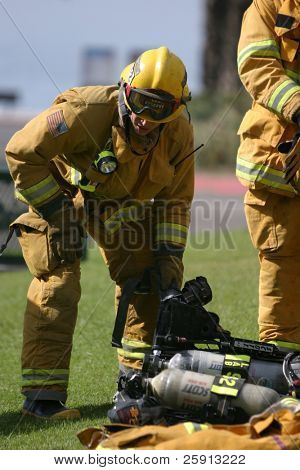 LAGUNA BEACH, CA - FEB 19: Firefighter recruits take a break during fire fighting drills at the local Fire Department training area on February 19, 2009 in Laguna Beach, California.