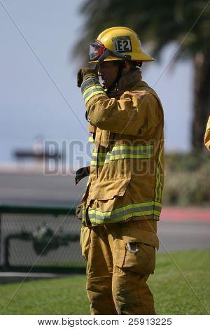 LAGUNA BEACH, CA - FEB 19: Firefighter recruit takes a break during fire fighting drills at the local Fire Department training area on February 19, 2009 in Laguna Beach, California.