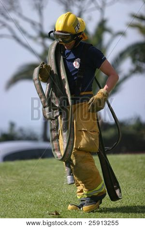 LAGUNA BEACH, CA - FEB 19: Firefighter recruit packs up after fire fighting drills at the local Fire Department training area on February 19, 2009 in Laguna Beach, California.