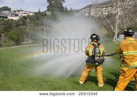 LAGUNA BEACH, CA - FEB 19: Firefighter recruits in action during fire fighting drills at the local Fire Department training area on February 19, 2009 in Laguna Beach, California.