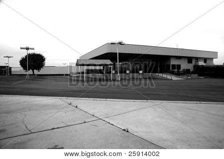 an empty car dealership  in black and white for impact state of the economy series