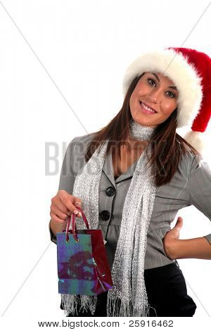 an attractive young woman wears a santa hat and goes shopping, isolated on white