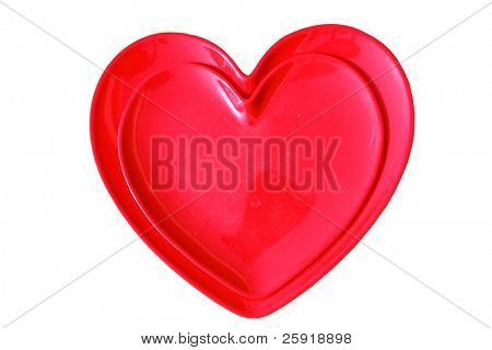 red heart shaped trays stacked upon each other isolated on white