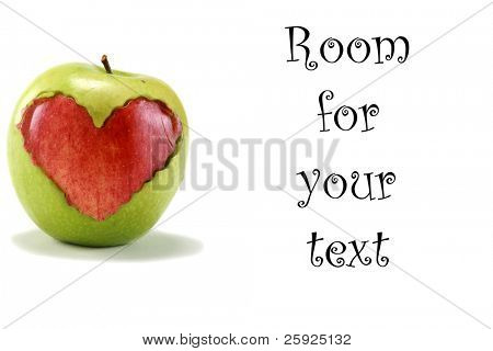"a green ""granny smith"" apple with a red ""red delicious"" apple heart shape cut out and placed inside the middle of the green apple, isolated on white with room for your text"