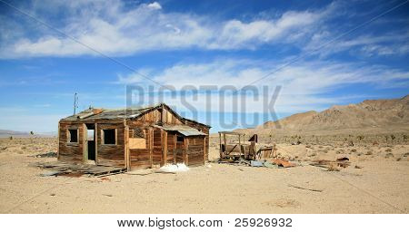remains of an old gold mine ghost town in nevada or californias wild west days of the 1800's