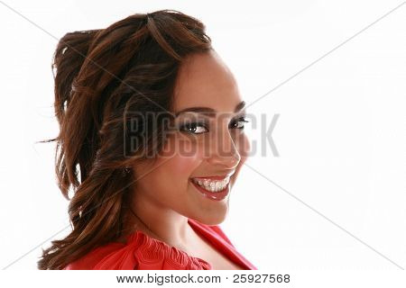 A beautiful african american woman smiles for her head shots during a Hair Style / Makeup / Fashion / Beauty photo shoot. Isolated on white with room for your text