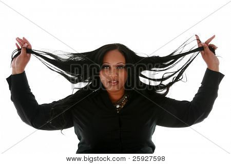 A beautiful african american woman plays with her hair in a Beauty / Hair / Fashion photo shoot. isolated on white with room for your text