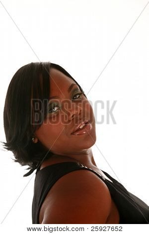 A beautiful african american woman smiles as she models her new hair style during her Fashion / Beauty / Hairstyle photo shoot. isolated on white with room for your text