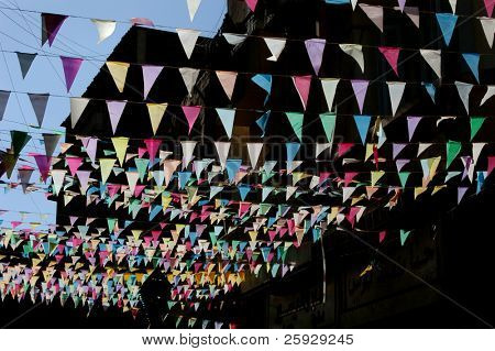 Multicoloured flags at a bazaar, traditional oriental street market, in Aswan, Egypt