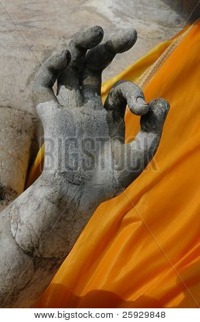 Stone hand of Buddha making OK sign from the temple of Nakhon Pathom, Thailand