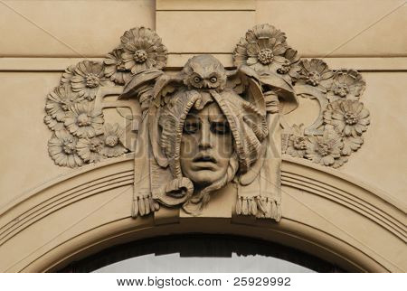 Allegory of philosophy, a stucco mask on the facade of the Municipal House in Prague, Czech Republic